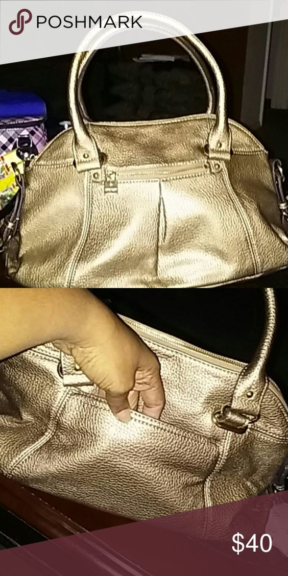 """Anne Klein Gold Handbag Anne Klein gold bag in excellent condition with external zipper pocket on front and open pocket on back. Gold accents and buckles. Inside zipoer pocket and open pockets. Appx 9""""x17""""x5.5"""" with 8"""" drop from double handles ( shoulder strap not included so I lowered price) Anne Klein Bags Satchels"""
