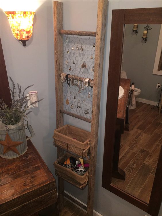 Old ladder used for bathroom organization. Could redo the vanity in the 1/2 bath with pallet wood and then use a ladder in the corner...                                                                                                                                                      More