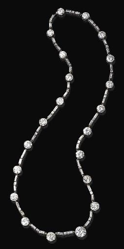AN ELEGANT ART DECO DIAMOND NECKLACE, BY BOUCHERON. Designed as a series of twenty-one graduated diamond collets, joined by square and baguette-cut three-stone diamond links, mounted in platinum, circa 1925, 20½ ins. Signed Boucheron, Paris.