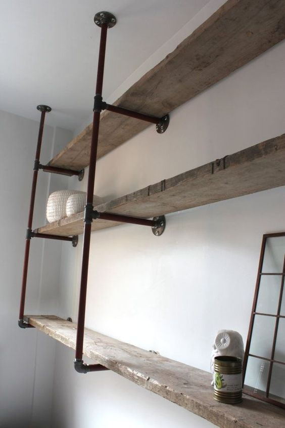 Reclaimed scaffolding boards and steel pipe wall mounted for Attaching shelves to plastic shed