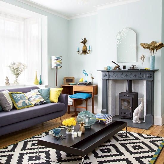Retro living room with tropical themed soft furnishings Living