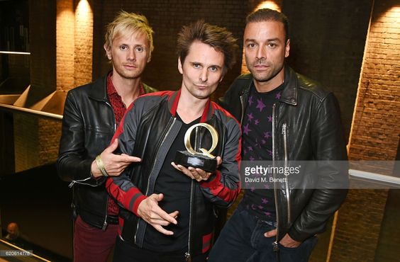 Dominic Howard, Matt Bellamy and Chris Wolstenholme of Muse, winners of the Best Act In The World Today award, pose at The Stubhub Q Awards 2016 at The Roundhouse on November 2, 2016 in London, England.: