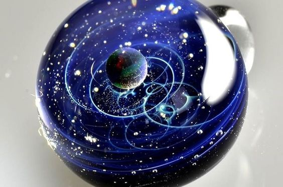 Ever wanted to know what it felt like to hold the cosmos on the end of a string?Japanese glass artist Satoshi Tomizugives you the opportunity t