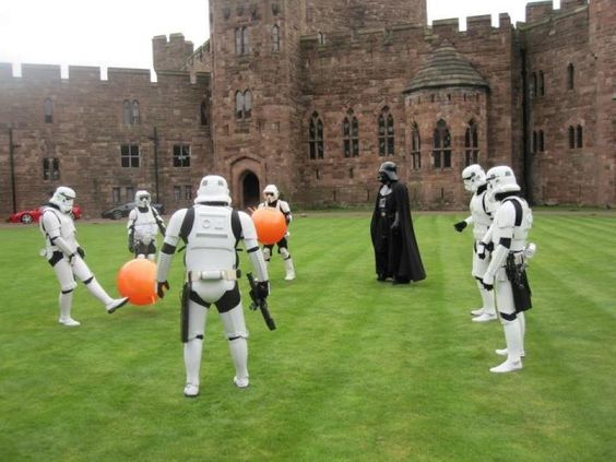 Darth Vadar and his storm troopers playing ball at hogwarts?