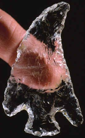 Hopewell Point (Middle Woodland Culture - 2,000 to 1,600 Years Ago).  Found by a farmer in a cache of Hopewell artifacts in Indiana. It was made from a  very clear Quartz Crystal that probably originated from the Arkansas area. The curved blade edge and exotic material are traits seen on other ritual objects connected to the Hopewell culture. Obsidian and a rare variety of deep blue green Flint Ridge chert was also found with this artifact.