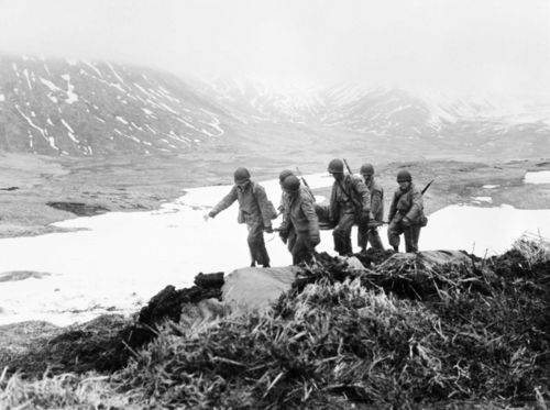 US soldiers moving the wounded. Battle of Attu, Alaska.
