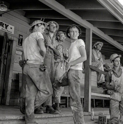 "June 1942. ""Shasta Dam, Shasta County, California. Workmen on porch of com­mis­sary."" Photo by Russell Lee for the Office of War Information.  Prints from $15."