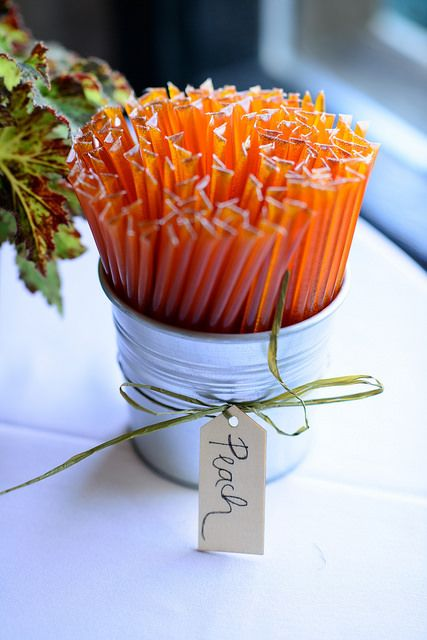 Garden party wedding favors of flavored honey sticks (peach, orange, and more). Brown Brothers Catering at Manderley Reception Center in Provo, Utah.