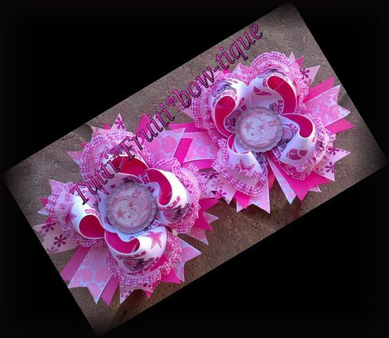 Pink Football Bow BowBratz by tuttifruitibowtique on Etsy, $13.00  http://www.facebook.com/pages/Tuttifruitibow-tique/144278845605678