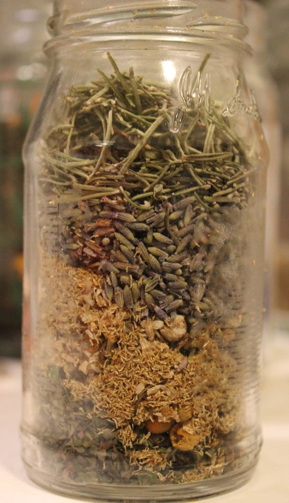 Healing herbal liniment for cuts and scrapes - rubbing alcohol, witch hazel and dried herbs