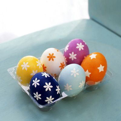 Decorating Easter Eggs: Use simple-shaped paper punches (available at k8memories.com) to cut forms from painter's masking tape. Smooth tape pieces onto clean, white eggs, and dye the huevos. Let eggs dry completely and remove tape to reveal lovely white patterns.