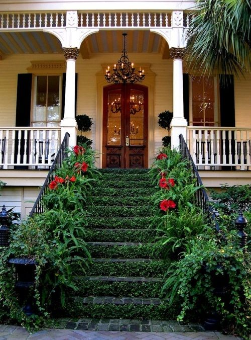 Love the double doors, light fixture and stairs!