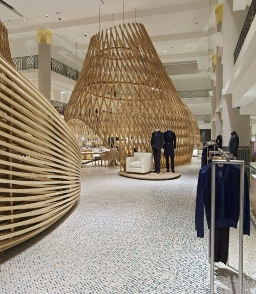 Nice use of wood latticing to create large-scale sculpture AND intimate spaces in this retail space
