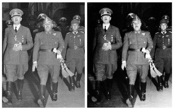 Franco y hitler - A Franco le cambian la cara por la de otra fotografía, ya que en la original salió con los ojos cerrados, además oscurecen un poco el fondo y de paso a los que van detrás de Hitler y él, supongo que para que nadie les robe protagonismo.