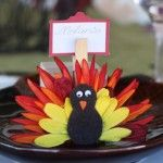 turkey place cards made from fabric flowers.