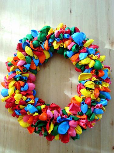 Balloon wreath tutorial. Helpful hint - use foam tubing from plumbing dept at home depot.