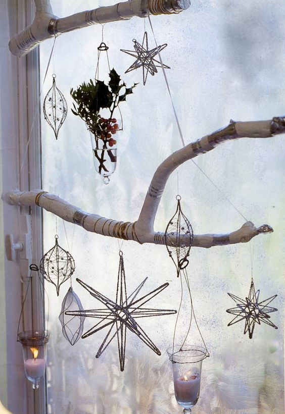 branch decor in a window with sun catchers
