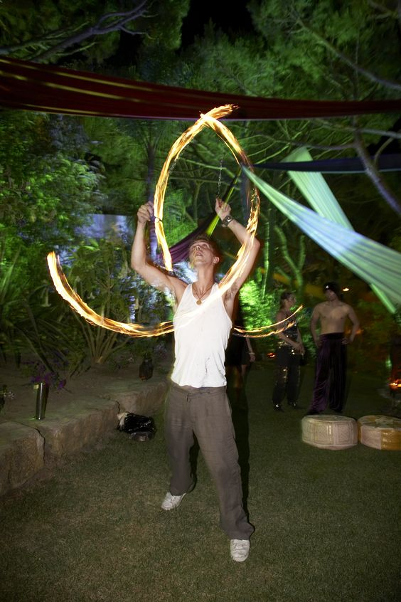 Fire Poi with outside drapery seen in the background #partyentertainment http://www.collection26.com/events/services/private-events/
