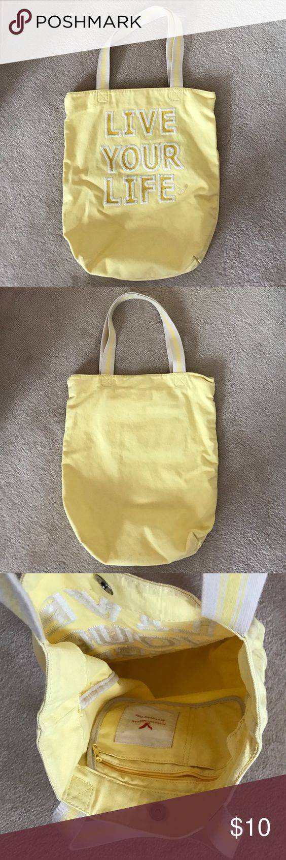 American Eagle Tote Pre-owned Live Your Life embroidered tote bag in yellow. No smell. Snap close. One inside zip pocket and two nonzip pockets. American Eagle Outfitters Bags Totes