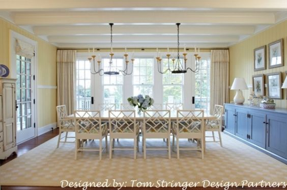 Love the wall color with white trim, ceiling, blue painted sideboard, rug, white painted cabinet