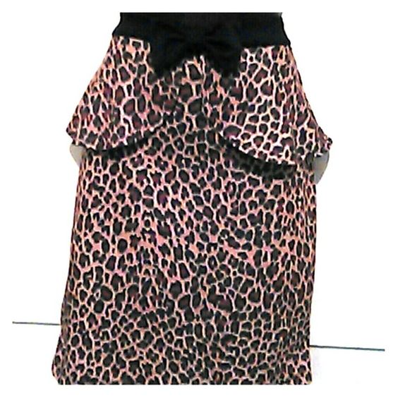 "Animal Print Peplum Skirt w/bow NWOT hand washed and hung in my closet Skirt has a lot of stretch to it  20"" length 15"" waist - double measurements 18"" hips -double measurements Skirts Mini"