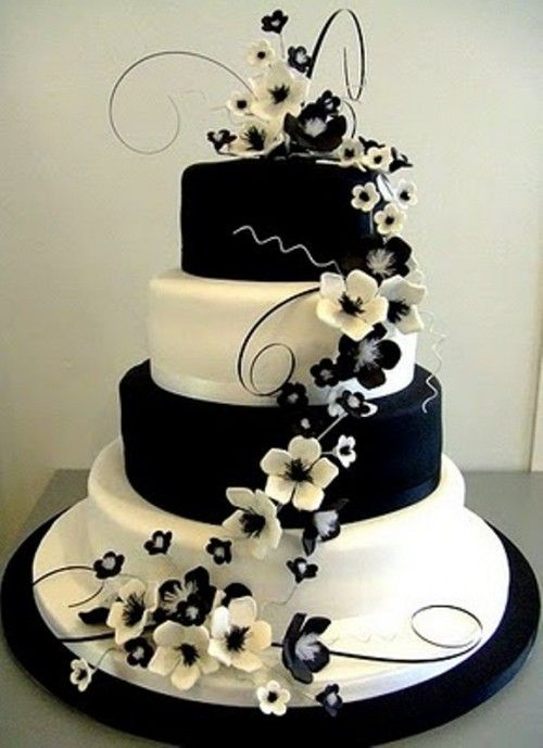 Black and white wedding cake - like the design of the flowers cascading down the cake