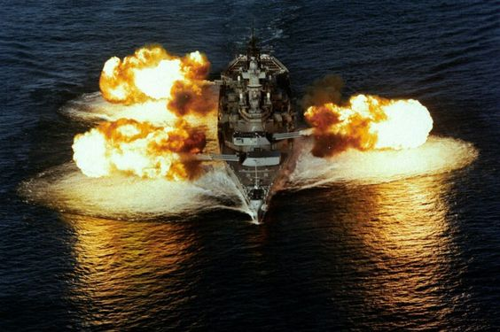 U.S.S. Iowa firing 16-inch guns.