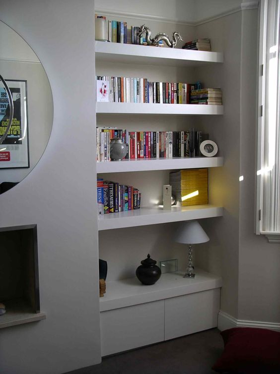 floating shelves on hidden fixings. Chubby shelves for either side of fireplace.