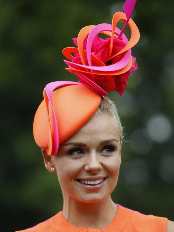 Stunning: Welsh soprano Katherine Jenkins looked wonderful in orange silk and was joined by Bollywood favourite, Aishwarya Rai, on day one of Royal Ascot