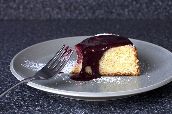 lime yogurt cake with blackberry sauce. so moist and delicious!