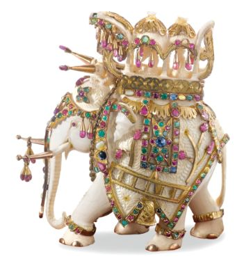 AN INDIAN CARVED IVORY ELEPHANT MOUNTED IN GOLD AND JEWELS, RETAILED BY VAN CLEEF & ARPELS, NEW YORK,  20TH CENTURY