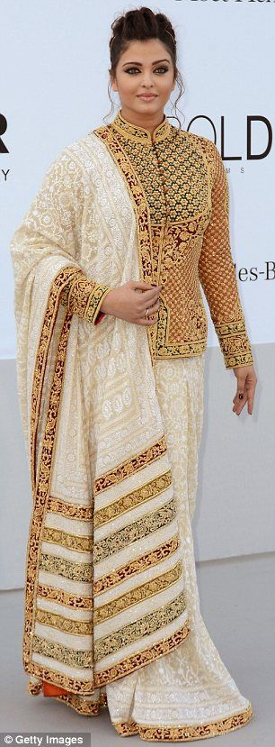 Star turn: Baby weight or not, Aishwarya looked every inch the Bollywood beauty in a gold embroidered sari and co-ordinating tailored jacket with Mandarin collar at the AmfAR Cinema Against Aids gala
