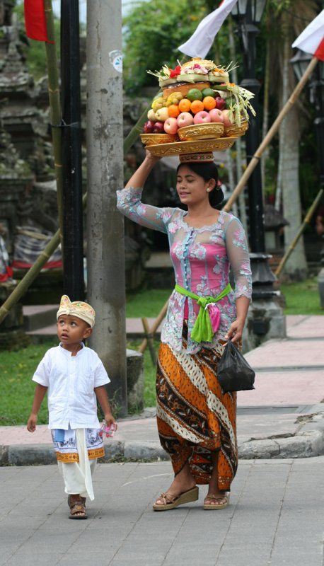 mother and child going to temple with their offering, so lucky that I was invited to one, simply amazing!