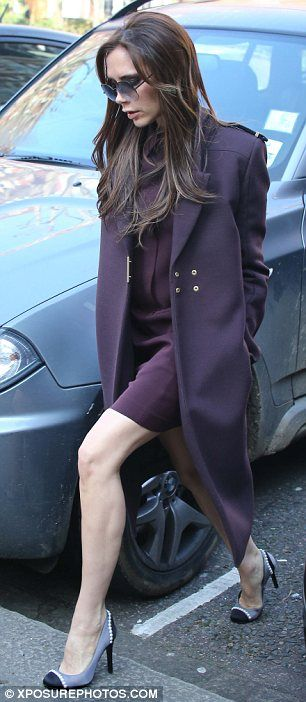Victoria Beckham.. wearing a coat from her own Fall 2012 collection, and Chanel heels.