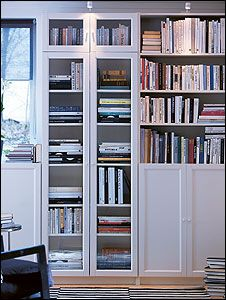 White IKEA Billy bookcase with doors. My final bookcase/home office storage decision. Looks so crisp and cheery.