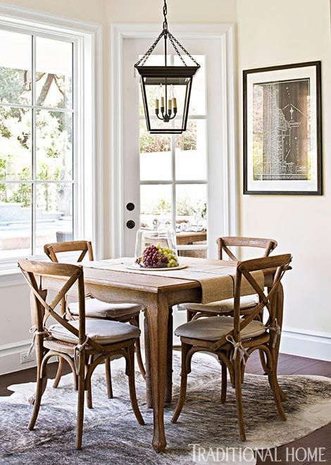 Bill and Giuliana's breakfast nook is balanced by an oversized lantern above a rustic wooden table - Traditional Home® / Photo: Michael Garland / Design: Lonni Paul: