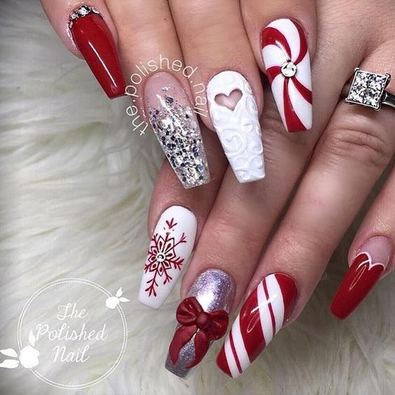 Winter nails with snowflake; red and white Christmas nails