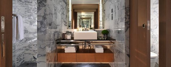 Belgraves - A Thompson Hotel: Bathrooms (like the Thompson Suite's) are decked out with cool marble walls and floors.
