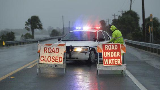 Police block the road entering Cedar Key, Fla., as Hurricane Hermine neared the…