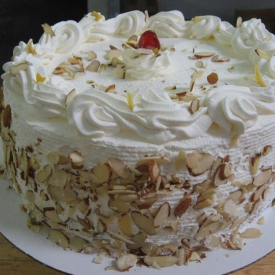 Italian Rum Cake by Freda | Just a Pinch ((FYI--I would NEVER use corn syrup in whipped cream--ick!))
