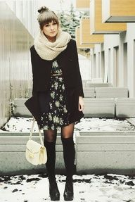 Top knot bun with bangs, infinity knit scarf, floral dress, oversize jacket, sheer black tights, knee-high socks, combat boots