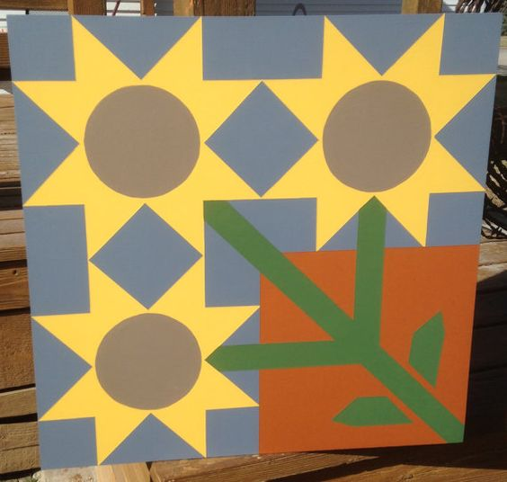 This 2 ft. x 2 ft. Sunflower Patch barn quilt was hand painted on MDO plywood and finished with 3-4 coats of exterior primer to protect from the elements. It is a perfect addition to your barn, garage, front porch or garden fence! No hanging hardware included. Made and shipped from Kansas.  Thank you for your interest in our shop! Please check us out on Facebook for even more current designs and design ideas.  www.facebook.com/frontporchtreasures/