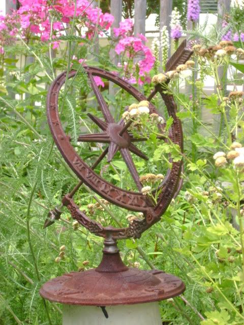 The sun dials helps keep track of the time when working in the garden.  Love it!