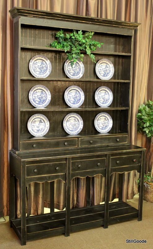 Tall black pine cabinet with open plate rack hutch. Base has 3 ...