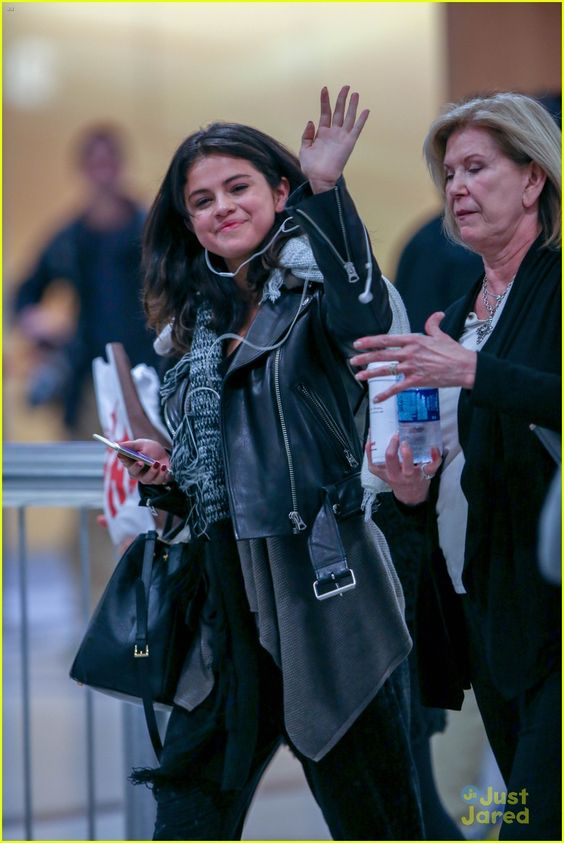 0fbc36816615 Selena Gomez is in good spirits while touching down on a flight on Monday  (February