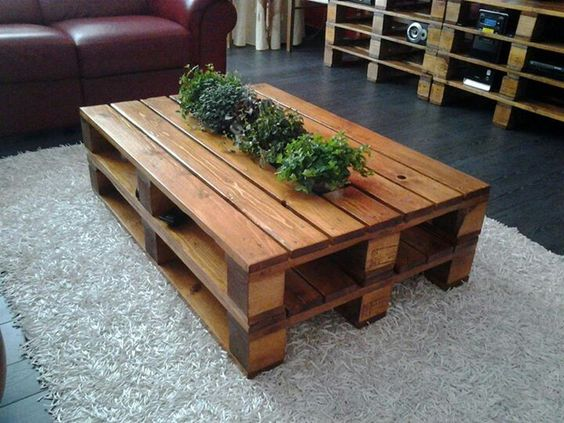 Diy pallet table - gorgeous finish. LOVE love the cut out in the center for plants!!