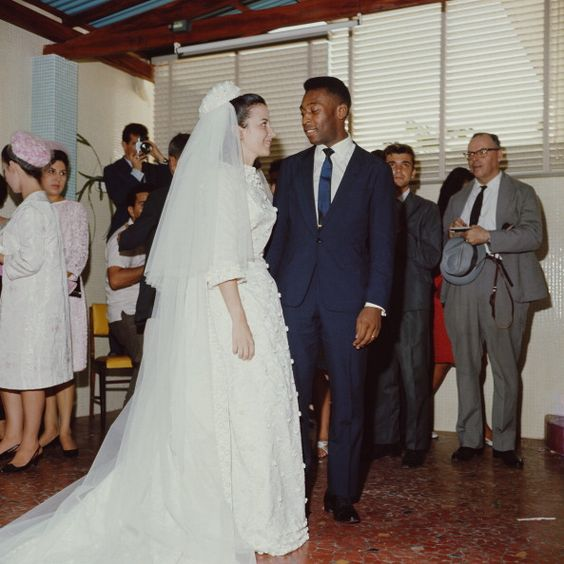 Brazilian footballer Pele (Edson Arantes do Nascimento) marries Rosemeri dos Reis Cholbi at a wedding ceremony in 1966.