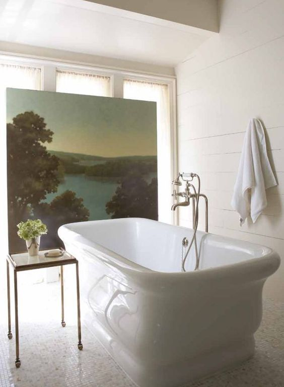 Large scale oil painting adds scenery and privacy; Bates Corkern   (love the shape of that tub too!)