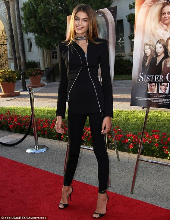 Stepping into the shoes: Kaia wore a bold zipped top over black leggings and…