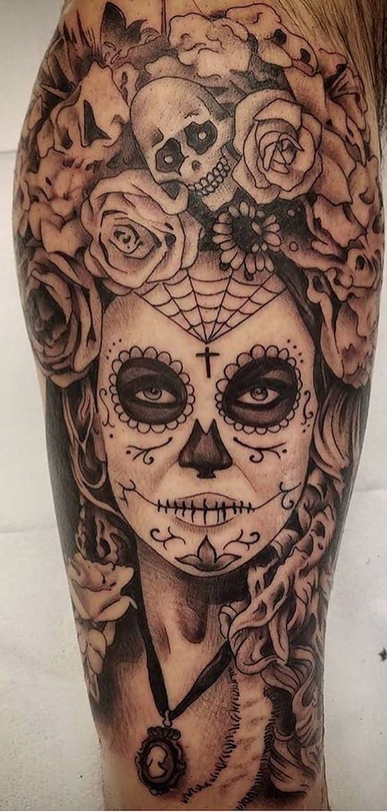 20 Day Of The Dead Tattoos That Will Inspire You To Celebrate Life Skull Sleeve Tattoos Skull Girl Tattoo Sugar Skull Girl Tattoo